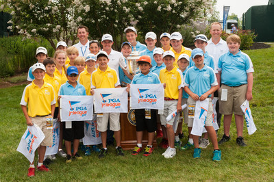 LOUISVILLE, KY - AUGUST 5: Rory McIlroy poses for a photo with PGA Junior League members during Practice Rounds at the 96th PGA Championship, at Valhalla Golf Club, on August 5, 2014 in Louisville, KY. (Photo by Montana Pritchard/The PGA of America) (PRNewsFoto/PGA of America)