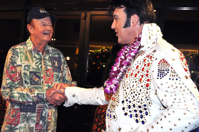 "Tom Moffatt, who played a big part in Elvis' multiple visits to Hawaii and a friend to Elvis, greets Burn'n Love star Darren Lee. Tom was quoted as saying of the show, ""Best new show in Hawaii in years... I actually thought I was watching Elvis!"" (PRNewsFoto/Burn'n Love)"