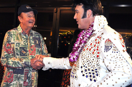 """Tom Moffatt, who played a big part in Elvis' multiple visits to Hawaii and a friend to Elvis, greets Burn'n Love star Darren Lee. Tom was quoted as saying of the show, """"Best new show in Hawaii in years... I actually thought I was watching Elvis!"""" (PRNewsFoto/Burn'n Love)"""