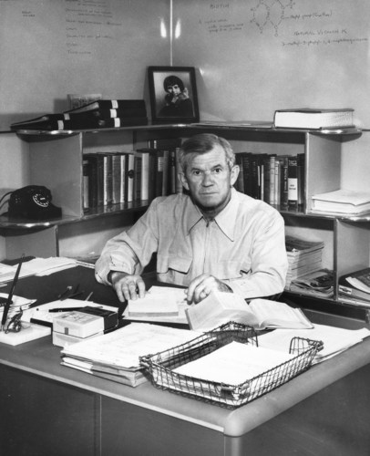 Carl F. Rehnborg in his Buena Park, California, U.S., office circa 1950. In the background is a photo of his ...