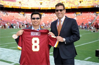Ming He, Country General Manager for Huawei in the U.S. (left), and Rod Nenner, Vice President of the Washington Redskins (right), today announced the team sponsorship and partnership