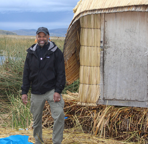 Ken Banks in front of adobe-style home with thatched roof in Puno, Peru.  (PRNewsFoto/Johns Hopkins Bloomberg School of Public Health/Ken Banks)