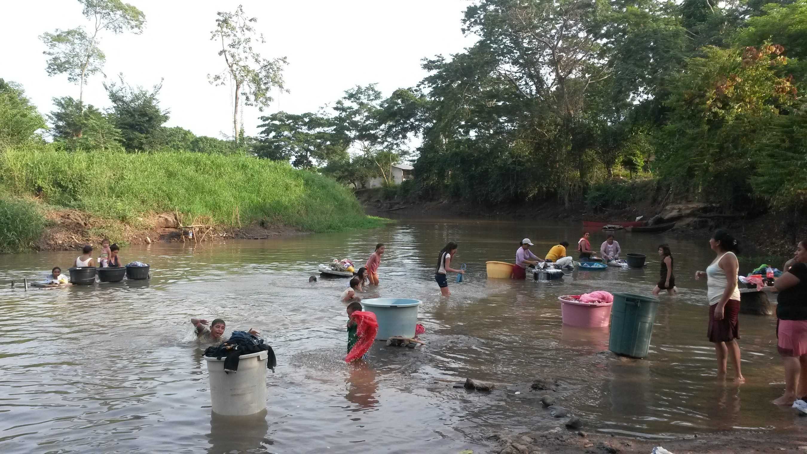 WASH President Eric Harrison recently visited Guatemalan villages near large banana farms sourced by Chiquita.  In this photo, local villagers wash clothes in water polluted by pesticides.