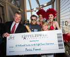 Paris Las Vegas Regional President David Hoenemeyer and Jubilee! showgirls award the Eiffel Tower Experience 10 Millionth Visitor Martin Layton and his fiance Sarah Connell with a trip for two to Paris, France.  (PRNewsFoto/Paris Las Vegas, Erik Kabik/Retna)