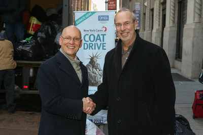 New York Cares executive director Gary Bagley thanks Greater New York Automobile Dealers Association president Mark Schienberg for organizing the collection of 6,000 coats from NYC area franchised automobile dealers.