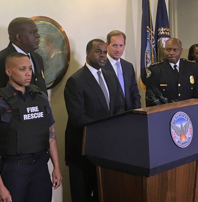 Atlanta Mayor Kasim Reed, at podium, joined by Georgia Power CEO Paul Bowers and Atlanta Police Chief George Turner announce a $900,000 donation to the Atlanta Police Foundation to purchase tactical body armor including bulletproof vests and helmets for Atlanta police officers.