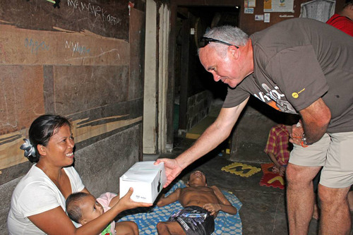 Hard Rock International President and CEO, Hamish Dodds delivers food to families in Bali as part of the global  ...