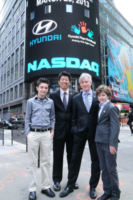 "(Left to right) Hyundai Hope On Wheels National Youth Ambassador CJ George, Hyundai Hope On Wheels Board Member Mickey Pong, Hyundai Motor America President and CEO John Krafcik and star of the hit television show ""Modern Family"" Nolan Gould joined for the ringing of theNASDAQ closing bell.  (PRNewsFoto/Hyundai Motor America)"