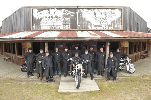 Scott Ressmeyer, seated on the center motorcycle, is joined by 11 men for the 2013 Ride for Miracles. The ...