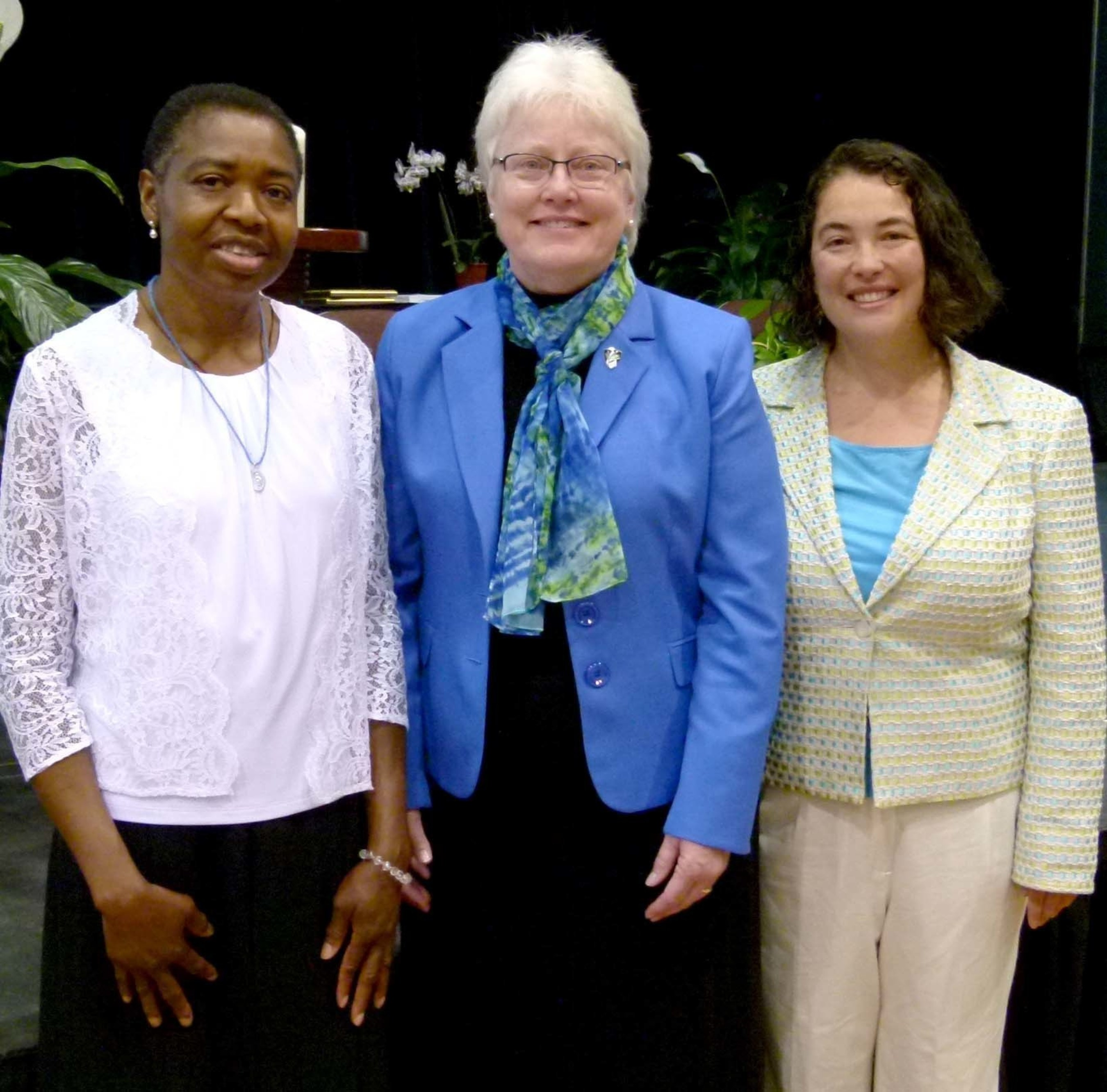 The newest members of the Dominican Sisters of Peace, Sisters Margaret Uche (far left) and Ana Gonzalez (far right) with Sister Patricia Twohill, Prioress.