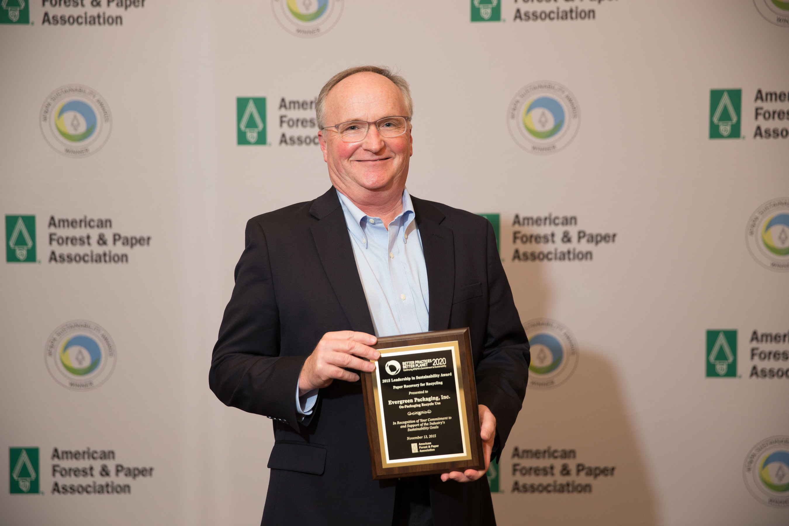 Derric Brown, director of sustainability for Evergreen Packaging, accepts the American Forest & Paper Association's 2015 Leadership in Sustainability Award for Evergreen's On-Packaging Recycle Use project.
