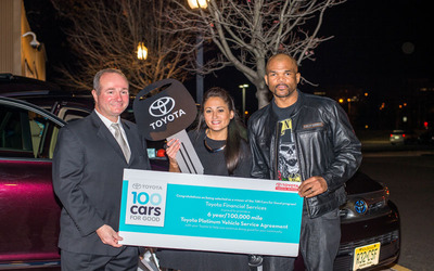 """Team Toyota Marketing Director Chris Branchide, One Simple Wish founder Danielle Gletow and Darryl """"D.M.C."""" McDaniels of Run-D.M.C. celebrated the delivery of a Toyota Highlander on Nov. 23, 2013 as part of the 100 Cars for Good program.  (PRNewsFoto/Toyota)"""