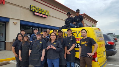 Owner/Operator Lynda Tran (center) celebrates the grand opening of the newest Dickey's Barbecue Pit in Washington, PA with the store's pit crew.
