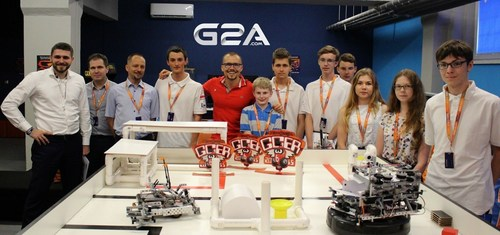 Bartosz Skwarczek and Dawid Rozek (CMO),  with group of young scientists visiting G2A before going to the Botball Tournament in Florida (PRNewsFoto/G2A.com)