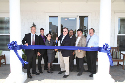 Aimco Director of Operations Ben Egge, Aimco Vice President of Redevelopment Sean Finnegan, Pacific Bay Vistas Community Manager Windy Archibald, San Bruno Mayor Jim Ruane, City Council Members Rico Medina, and Ken Ibarra, and former Mayor Larry Franzella cut the ribbon to mark the grand opening of Aimco's Pacific Bay Vistas apartment community.  (PRNewsFoto/Aimco)
