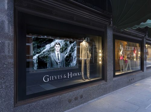 Gieves & Hawkes enhances its presence in London's most prestigious department store with a digital window display delivered by AVMI (PRNewsFoto/AVM Impact Ltd)