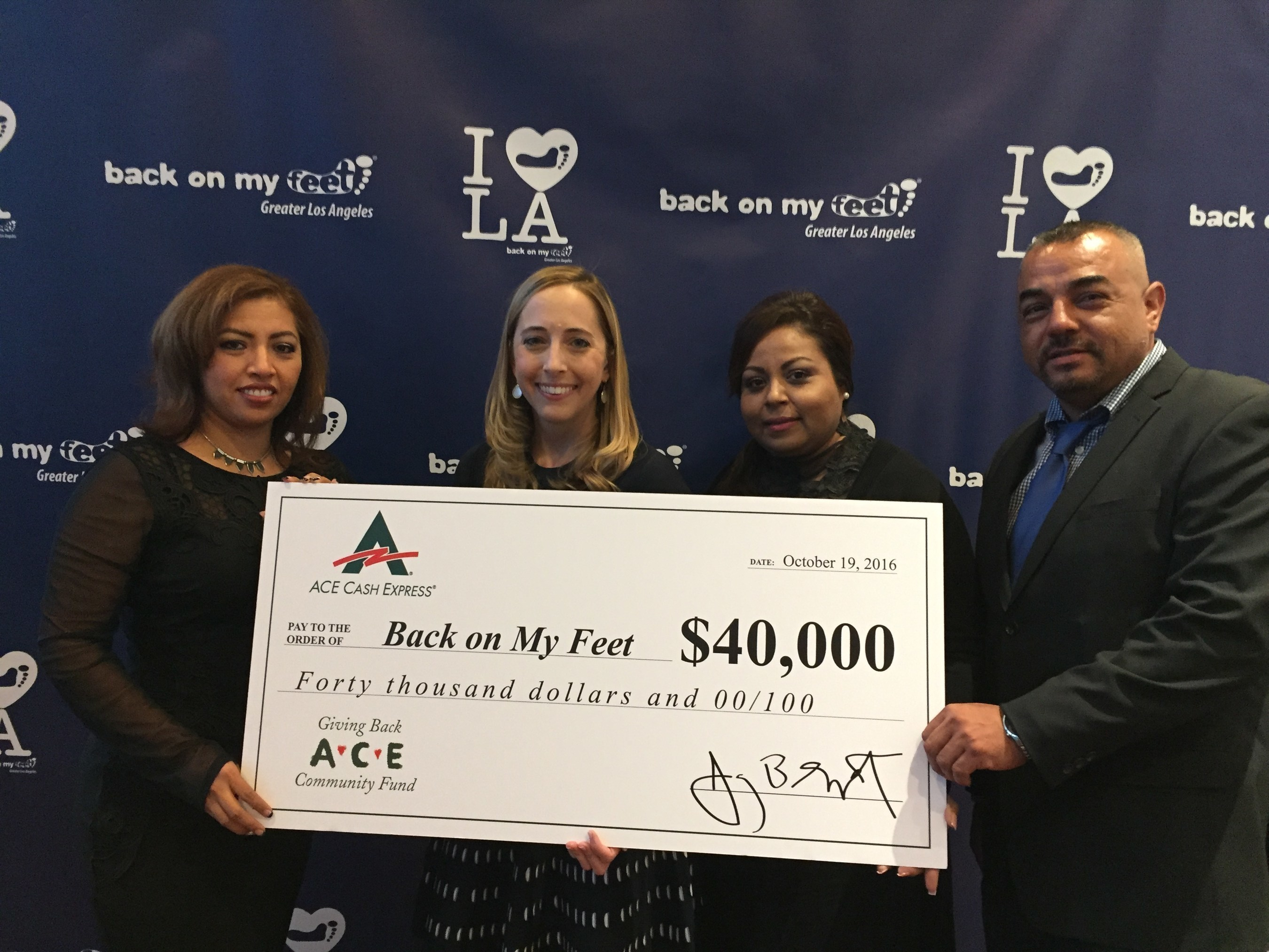 Pictured:  ACE representatives present check to Susan Patena, Development Director, Back on My Feet Greater Los Angeles