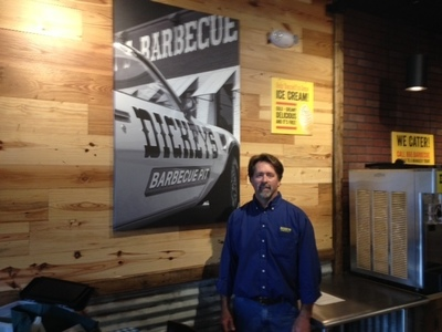 John Clark in his new store in Brentwood, Tennessee. The store opens on June 19 and is located at 8113 Moores Lane, suite 1900. (PRNewsFoto/Dickey's Barbecue)