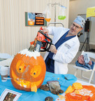 Pumpkin Patients: Lung transplant surgeon Dr. Ross Bremner takes his operating skills to a new level at St. Joseph's Hospital's annual surgeons' pumpkin carving contest in Phoenix, Arizona. Thirteen scalpel wielding surgeons competed in this year's Doc 'O Lantern competition.  (PRNewsFoto/St. Joseph's Hospital and Medical Center, Photographer: Brad Armstrong)