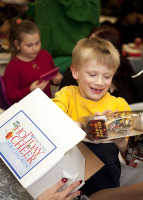 Henry Schein Holiday Cheer For Children Program enables more than 1,000 children and their families to have happier holidays.  (PRNewsFoto/Henry Schein, Inc.)