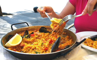 Crystal guests can learn how to make traditional paella with a hands-on cooking class in Barcelona this year.  (PRNewsFoto/Crystal Cruises)
