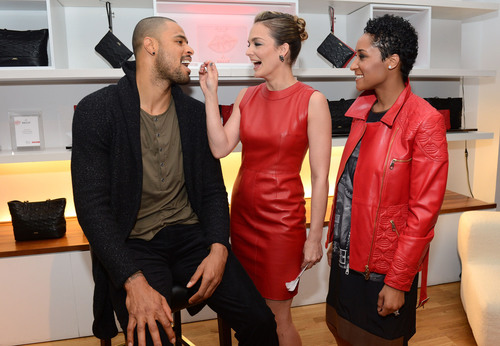 NY Knick Tyson Chandler getting his cheek swabbed by DKMS Delete Blood Cancer co-founder Katharina Harf and wife, Kimberly, wearing Bally Lips for Life Collection.  (PRNewsFoto/DKMS Delete Blood Cancer)