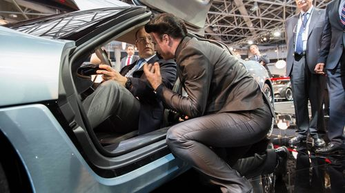 Prince Albert assures himself of the extraordinary interieur of the QUANT e-Sportlimousine with nanoFLOWCELL® ...