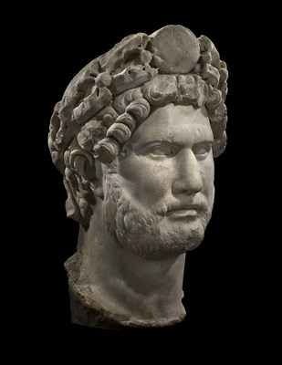 The rare marble portrait of the famous philhellenic emperor, Hadrian belonged to an impressive, larger-than-life sculpture and shows the emperor as commander in chief and Pater Patriae (Father of the Country) (PHOENIX ANCIENT ART- TEFAF NY -PARK AVENUE ARMORY- STAND 73)