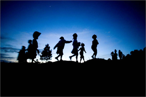 Hurricane-devastated clients in Haiti return home after receiving food relief and interest-free loans.  credit: Ben Depp.  (PRNewsFoto/CGAP, Ben Depp)