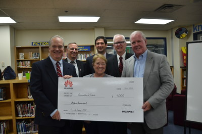 Huawei Makes Donation to Communities In Schools and Bowman Middle School in Plano, Texas. Pictured: Pat Craven (Communities In Schools Campus Manager), George Reed (Huawei), Kris Vernon (Bowman Middle School Principal), Plano City Councilwoman Andre' Davison, Dr. Richard Matkin (Plano Independent School District Superintendent), and Jim McGee (Huawei).