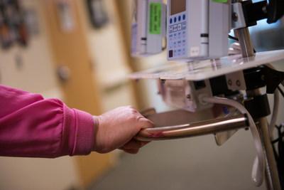 A Pullman Regional nurse displays an IV pole containing a copper handle. (PRNewsFoto/Copper Development Association..)