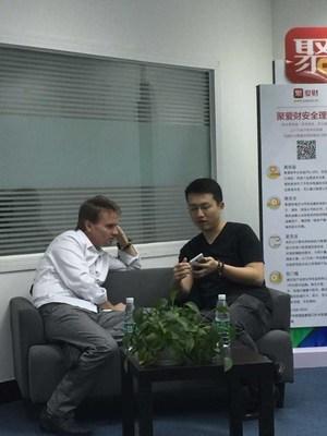 Heng Ren, CEO of Ju-Ai-Cai, demonstrates products to Peter Davison