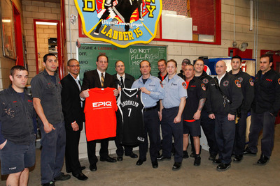 Director of Brand Management Sports Nutrition for EPIQ Brent Coward, Vice President of GNC Vincent Cacace, FDNY Chief John Bley, FDNY Captain David Drake, FDNY Lt. James Amsterdam (center) and the FDNY of Engine 4, Ladder 15 pose for a photo at EPIQ Thank You In Relief of Sandy on Tuesday, February 5, 2013 in New York City.  (PRNewsFoto/EPIQ)
