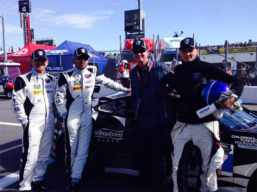 (L-R) Dempsey Racing driver Joe Foster, Dempsey Racing owner and driver Patrick Dempsey, Simmons Vice President of Beautyrest Brand Rolf Sannes and Dempsey Racing driver Marc Lieb with the newly Beautyrest Black-branded No. 27 Dempsey Racing Porsche GT America before the start of the Rolex 24 in Daytona, January 25, 2014. On Monday, January 27, Simmons Bedding Co announced a partnership between its Beautyrest Black brand and Dempsey Racing.  (PRNewsFoto/Simmons Bedding Company)