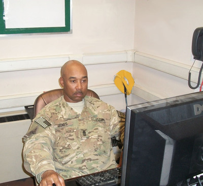 Sgt. Maj. Timothy Jones studies while deployed in Afghanistan.  (PRNewsFoto/Ashford University)