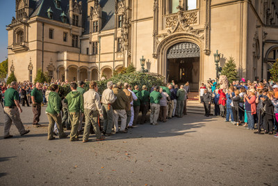 Biltmore crew members work together to carry the 3500-pound Fraser Fir into Biltmore House where it will reside for Christmas at Biltmore, running Nov. 4, 2016, through Jan. 8, 2017.