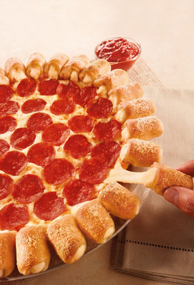 "The Cheesy Bites Pizza is back at Pizza Hut. Adorned by 28 pullable, dippable, poppable cheese-filled morsels around the crust, the Cheesy Bites Pizza combines taste perfection with a little ""food fun,"" taking pizza night from good to great.  (PRNewsFoto/Pizza Hut)"