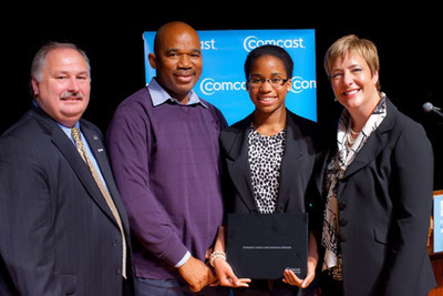 The Comcast Foundation awarded 83 New Jersey high school seniors $1,000 scholarships through its annual Leaders and Achievers(R) Scholarship Program.  Adeima Ibanga (second from right), of Charles E. Brimm Medical Arts High School in Camden, was awarded a $10,000 Comcast Founders Scholarship. She is pictured with her father Ubokudom Ibanga (second from left), Comcast's Regional Senior Vice President LeAnn Talbot (far right) and Vice President of Government & Regulatory Affairs William Kettleson (far left).  (PRNewsFoto/Comcast Cable)