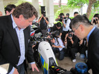 Craig Bramscher, CEO of Brammo Inc. and Gary Locke, U.S. Commerce Secretary inspecting the Brammo Enertia electric motorcycle used by the Hong Kong Police. (PRNewsFoto/Brammo Inc)