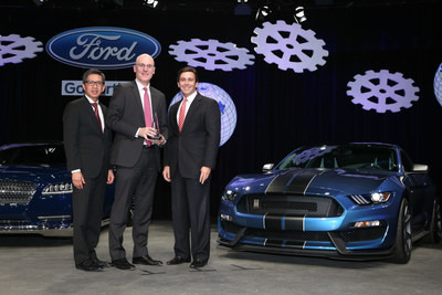 James Verrier, President and Chief Executive Officer, BorgWarner (middle), accepted a 2014 World Excellence Award from Hau Thai-Tang, Group Vice President, Global Purchasing, Ford Motor Company (left), and Mark Fields, President and Chief Executive Officer, Ford Motor Company (right).