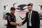 Dragon Racing managing director Oriol Servia and the strategic development director of InstaForex Roman Tsepelev shake hands celebrating long-term agreement (PRNewsFoto/InstaForex)