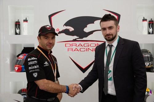 Dragon Racing managing director Oriol Servia and the strategic development director of InstaForex Roman Tsepelev shake hands celebrating long-term agreement (PRNewsFoto/InstaForex) (PRNewsFoto/InstaForex)