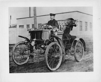 William Doud Packard on a Packard