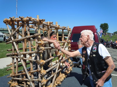 Gerald McCullar in POW cage shakes hands with Gerry Walters former WWII POW at Rolling Thunder, Inc. Ride for Freedom. (PRNewsFoto/Rolling Thunder, Inc.) (PRNewsFoto/Rolling Thunder_ Inc_)