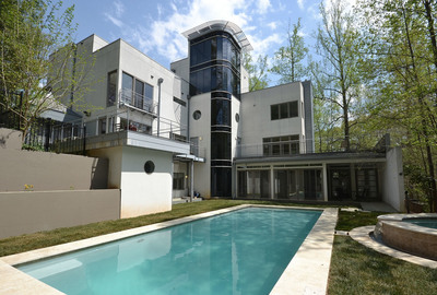Supreme Auctions Combines No-Reserve Absolute Auction of Ultra Sophisticated Modern Atlanta Home with Charity Auction on May 8, 2014.  (PRNewsFoto/Supreme Auctions)