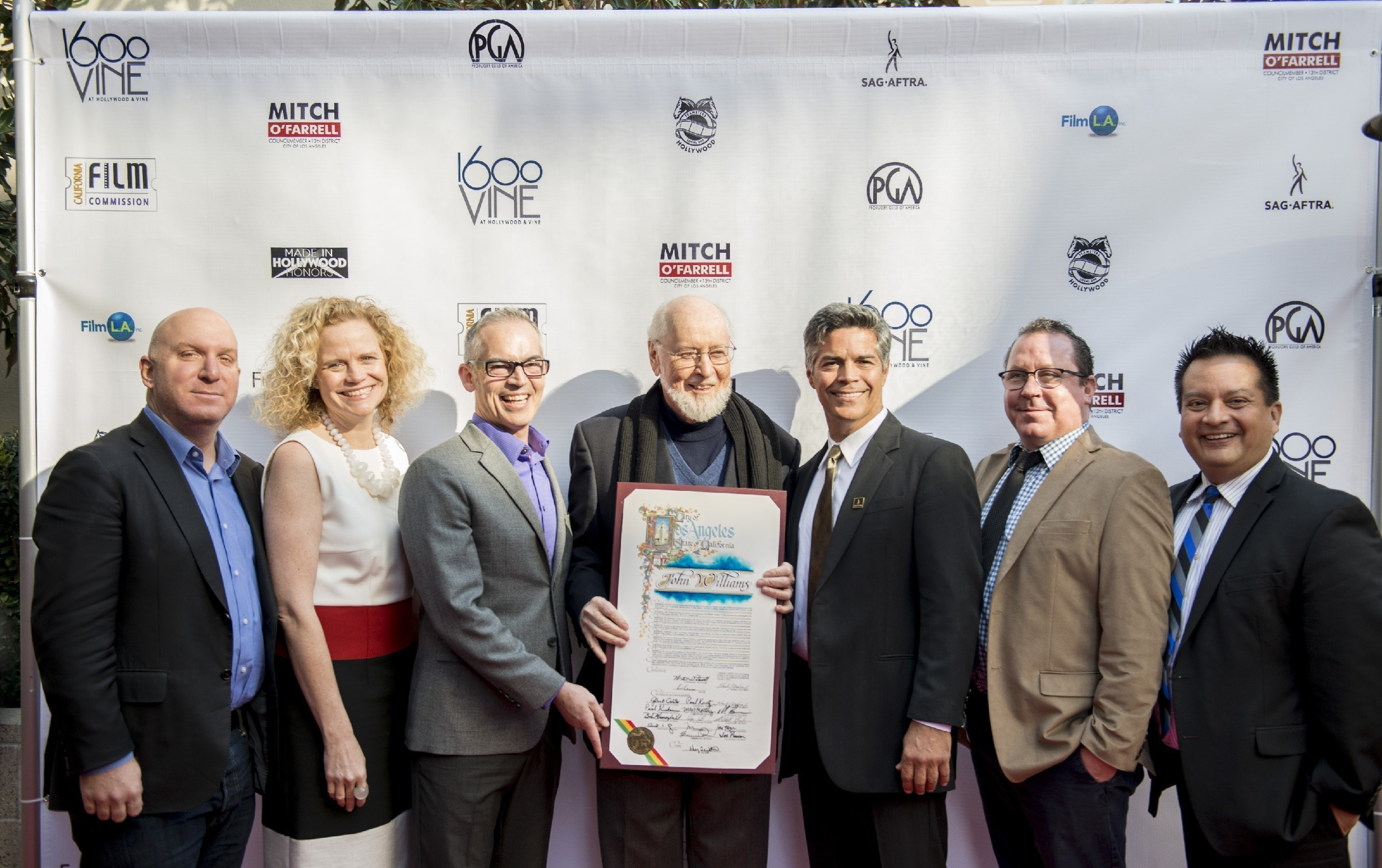 Made in Hollywood Honors 2016 Recipients Legendary composer John Williams, first recipient of the MIHH Lifetime Contribution to Hollywood Tribute joins Los Angeles City Councilman Mitch O'Farrel (to his right) and event host Esai Morales (to his left) with fellow honorees (from left to right) Straight Outta Compton producer Scott Bernstein, Inside Out screenwriter Meg LeFauve, and Anomalisa producers Joe Russo and James Fino (Photo courtesy of 1600 VINE)