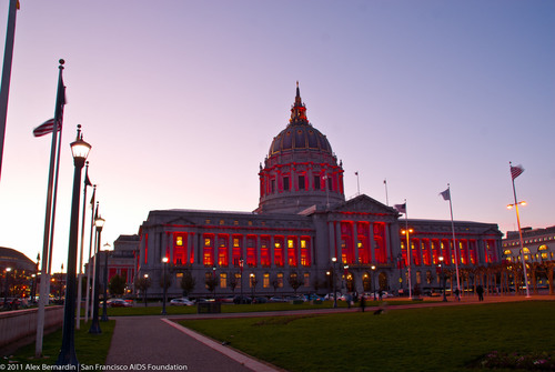 San Francisco City Hall bathed in red on December 1, 2011 to mark World AIDS Day.  San Francisco AIDS Foundation CEO Neil Giuliano says it's an important visible reminder to the world that HIV/AIDS still deserves urgent attention. Everyday in San Francisco there are approximately two new HIV infections, and gay and bisexual men, particularly those of color, are disproportionately impacted by the disease.  Over 19,000 people in San Francisco have died from the disease.  Of the estimated 1.2 million people living with HIV in the United ...