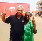 Larry Jennings with student in Rwanda (PRNewsFoto/Carnegie Mellon University....)