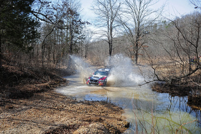 Travis Pastrana and Chrissie Beavis navigate a tricky water crossing at Rally in the 100 Acre Wood in their 2014 WRX STI.  (PRNewsFoto/Subaru of America, Inc.)