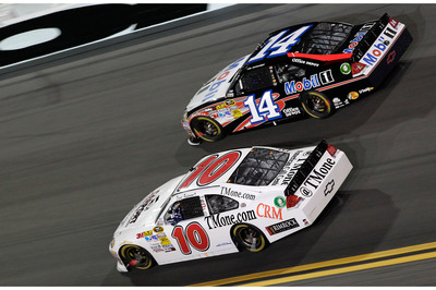 2011 NASCAR Sprint Cup Series Champion #14 Tony Stewart in the Mobil 1 / Office Depot Chevy races David Reutimann in the #10 TMone.com CRM Chevy at the Daytona Coke Zero 400 in July of 2012. Rusty Jarrett/MRD/CIA.  (PRNewsFoto/TMone)